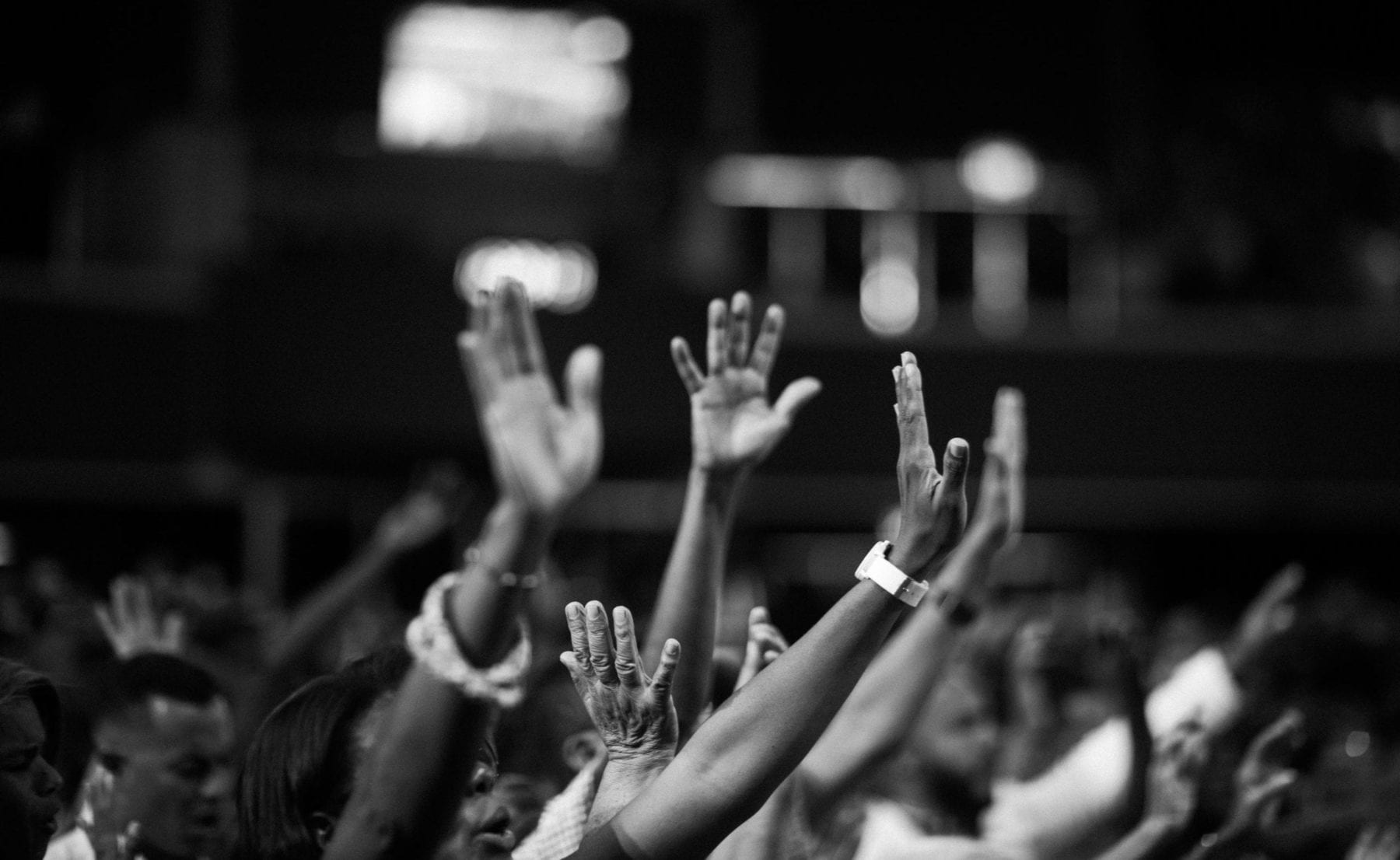 People raising hands image