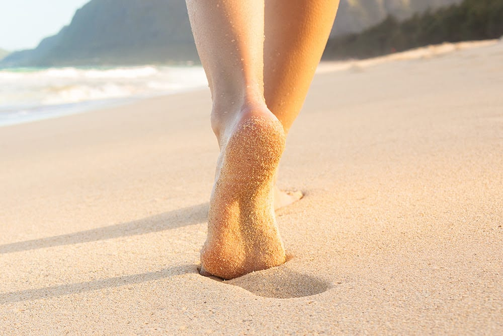 walking-on-the-sand-with-small-lump-called-plantar-fibroma